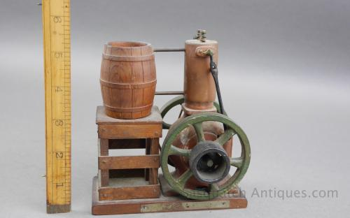 Vintage hand carved folk art scale model of a vertical hit miss engine for sale
